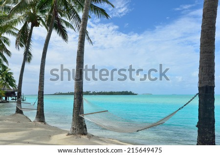 Line of hammocks on tropical Pacific Island. - stock photo