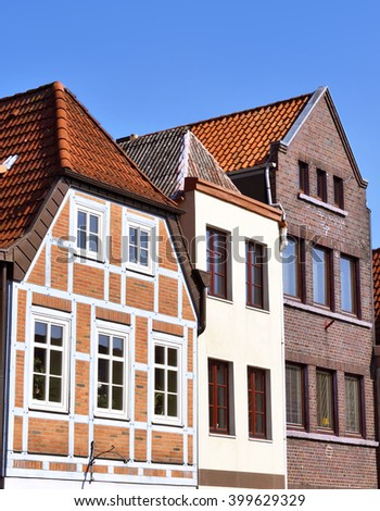 Line of houses in the old town of Buxtehude, Germany. Hamburg, North Germany. Historical city with old houses. Old facades. - stock photo