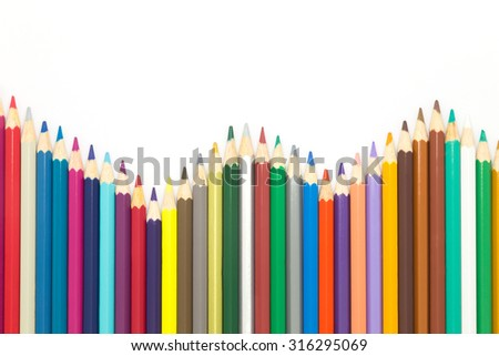 Line of mixed colors wooden pencils, on white bakground - stock photo