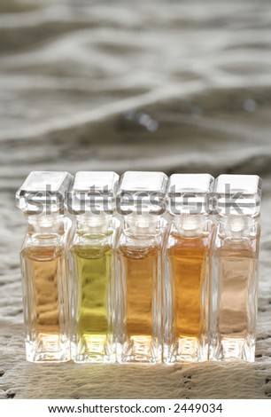 line of multicolor perfumes - stock photo