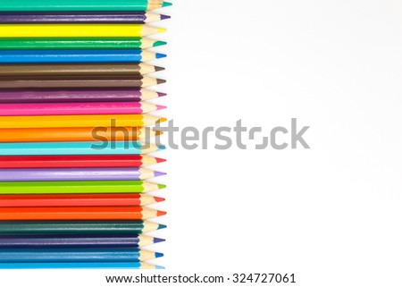 Line of multiple colors wooden pencils on white background