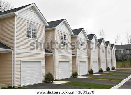 line of newly finished town homes ready for sale - stock photo