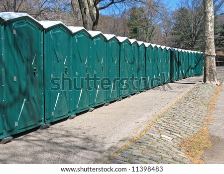 Line of portable toilets in Central Park, Manhattan, NYC - stock photo