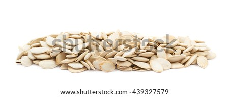 Line of pumpkin seeds isolated over the white background
