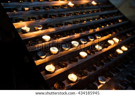 Line of round candles in the church at wedding ceremony - stock photo