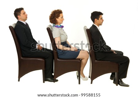 Line of three business people sitting on chairs in profile isolated on white background - stock photo