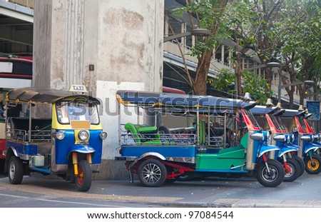 Line of tuktuks on Bangkok street, Thailand - stock photo