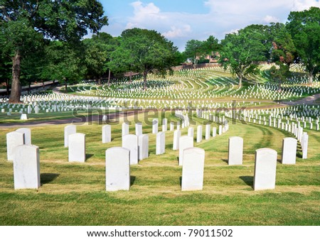 Line of veterans' tombstones at National Cemetery in Marietta, Ga. - stock photo