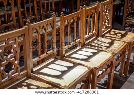 Line of wood chairs in a christian church - stock photo