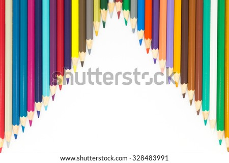 Line of wooden pencils multiple colours on white background - stock photo