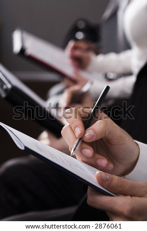 Line of writing hands - stock photo