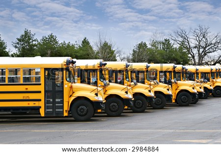 line of yellow school buses - stock photo