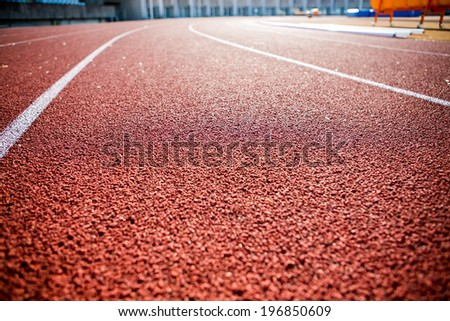 Line on running track with rubber cover - stock photo