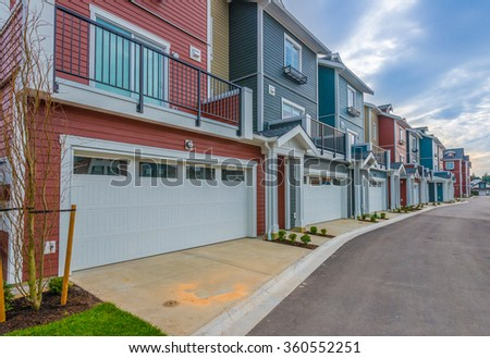 Line, row of townhouses. Nice and comfortable great neighborhood, community. - stock photo