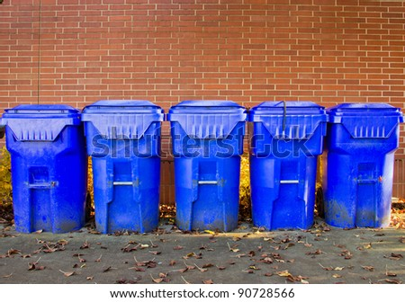 Line up of recycle bins outside of college cafeteria - stock photo