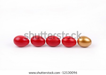 Line up Red Easter eggs with gold egg on white background