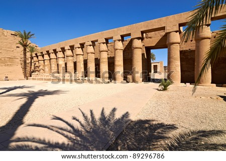 Linear perspective of columns and ram-headed sphinxes, Karnak temple, Egypt - stock photo