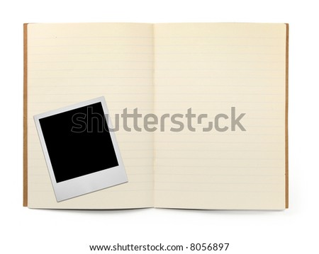 lined exercise book and photo frame on white, visible shadow in front - stock photo