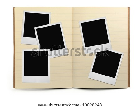 lined exercise book and photo frames, visible natural shadow in front - stock photo