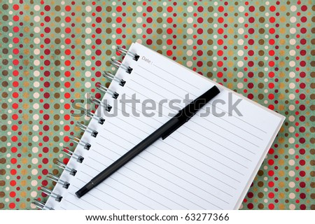 Lined notebook paper and black pen - stock photo