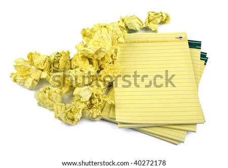 lined paper notebooks and crumpled paper on white background - stock photo