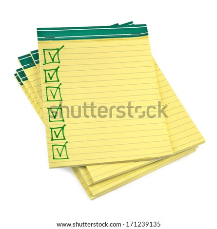 lined paper notebooks with completed checklist on white background - stock photo