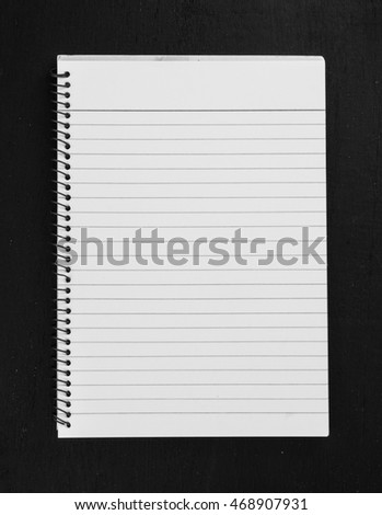 Lined paper of diary on dark chalkboard