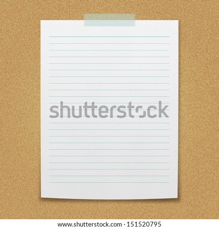lined paper sheet on board. - stock photo