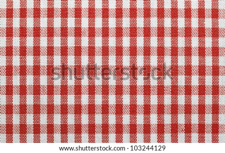 Lined red and white dinner clothes - stock photo