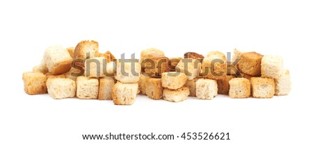 Lined up pile of garlic white bread croutons isolated over the white background - stock photo