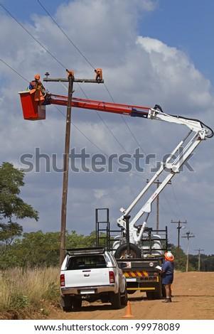 Linemen working on powerline - stock photo