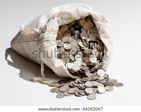 Linen bag of old pure silver coins used to invest in silver as a commodity - stock photo