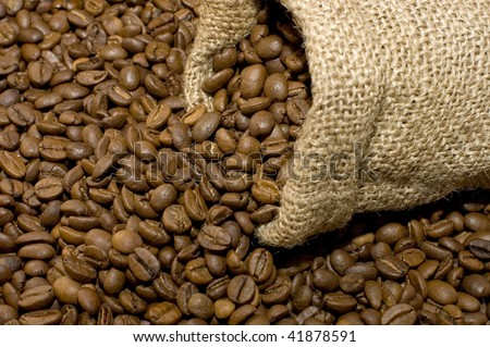 Linen bag with fragrant coffee on beans - stock photo