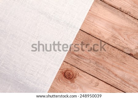 Linen cloth on an old wooden table. top view. concept - stock photo