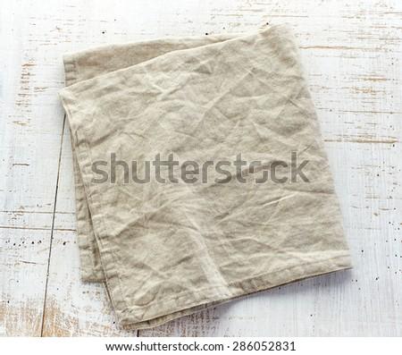 linen napkin on white wooden table - stock photo