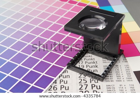 Linen tester with typometer and color sample. - stock photo