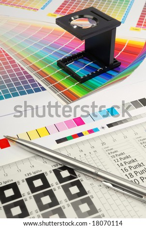 Linen tester with typometer and colour sample. - stock photo
