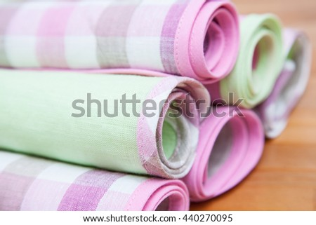 Linen towels on wooden background