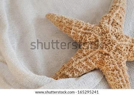 Linen with starfish as abstract background.
