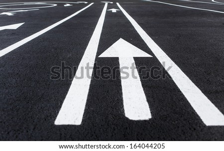 Lines and lane markings on the road / photography of road markings and traffic symbol on surface road  - stock photo