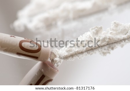 lines of cocaine and ten euro banknote - stock photo