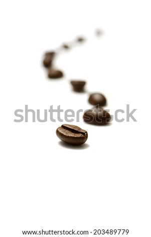 lines of coffee beans on white background