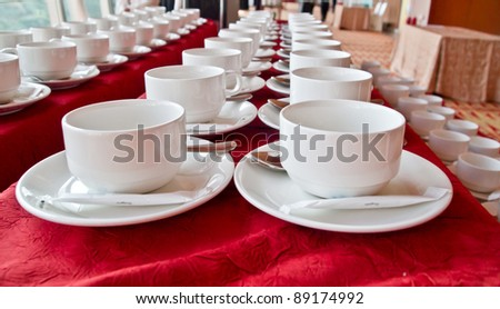 Lines of coffee cups in front of conference room - stock photo