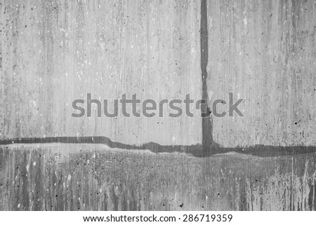 Lines of concrete construction blocks along a retaining wall. - stock photo