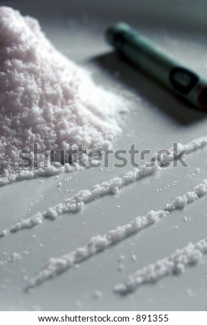 Lines of drugs ready for inhaling - stock photo