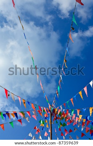 Lines of flags and blue sky