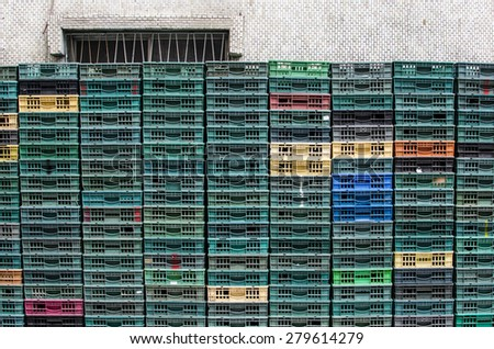 Lines of green, yellow orange and red racks outside an egg store.  - stock photo