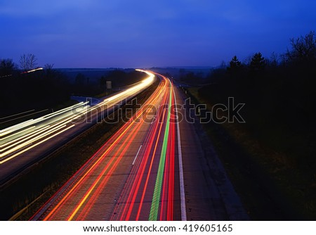 Lines of light cars on the highway. - stock photo