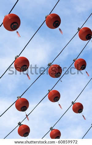 Lines of multiple red lanterns at Chinese temple - stock photo
