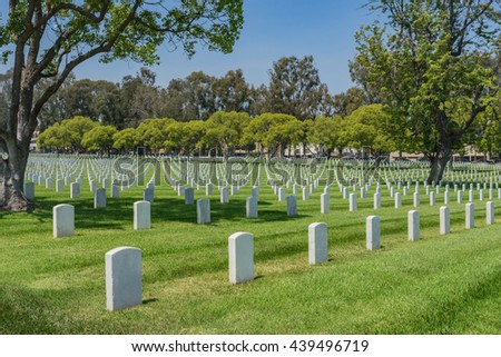 Lines of white grave stones mark resting place of American soldiers. - stock photo